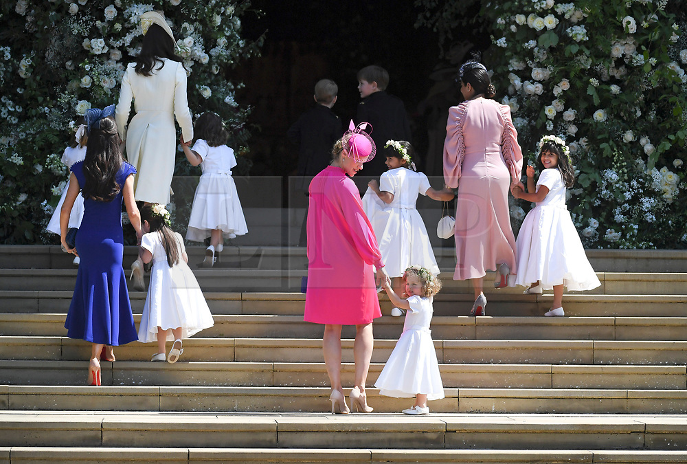 © Licensed to London News Pictures. 19/05/2018. London, UK.  PPage boys and bridesmaids, including PRINCE GEORGE and PRINCESS CHARLOTTE arrive at the weeding of Prince Harry, The Duke of Sussex and Meghan Markle, The Duchess of Sussex at St George's Chapel in Windsor Castle following a wedding ceremony. Photo credit: LNP