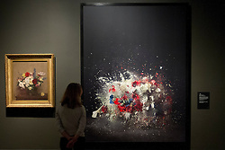 © Licensed to London News Pictures. 30/10/2012. London, UK. A National Gallery employee looks at Ori Gersht's 'Blow Up: Untitled 5' (2007) (R), displayed next to Ignace-Henri-Theodore Fantin Latour's 'The Rosy Wealth of June' (1886) at the press view for a new exhibition taking place at the London based gallery. The exhibition, entitled 'Seduced by Art: Photography Past and Present' is the National Gallery's first major exhibition of photography and runs from 31 October 2012 - 20 January 2013. Photo credit: Matt Cetti-Roberts/LNP