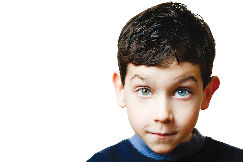 Young boy with blue eye on white background