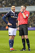 Millwall forward Lee Gregory (9) and Referee Michael Oliver smile during the The FA Cup fourth round match between Millwall and Everton at The Den, London, England on 26 January 2019.