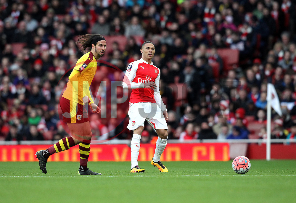 Kieran Gibbs of Arsenal passes the ball past George Boyd of Burnley - Mandatory byline: Robbie Stephenson/JMP - 30/01/2016 - FOOTBALL - Emirates Stadium - London, England - Arsenal v Burnley - FA Cup Forth Round
