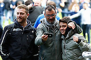 Millwall fans take a selfie photograph on the pitch after the Sky Bet Championship match at The Den, London<br /> Picture by David Horn/Focus Images Ltd +44 7545 970036<br /> 03/05/2014