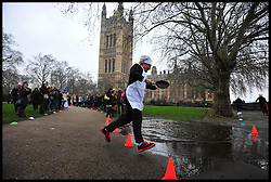 Martin Horwood Lib dem MP takes part in the MP's and Lords race against political Journalist in the Rehab Parliamentary Pancake Shrove Tuesday race a charity event which sees MPs and Lords joined by media types in a race to the finish. Victoria Tower Gardens, Westminster, Tuesday February 12, 2013. Photo By Andrew Parsons / i-Images