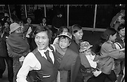 Vietnamese Refugees Arrive In Dublin  (N66)..1981..18.03.1981..03.18.1981..18th March 1981..As part of a resettlement plan initiated by the United nations, Ireland agreed to accept into the country a number of Vietnamese families displaced by the Vietnam war...A smiling Nga Van Thai carrying one of his children is pictured with the Vietnamese refugees on their arrival at Dublin Airport.