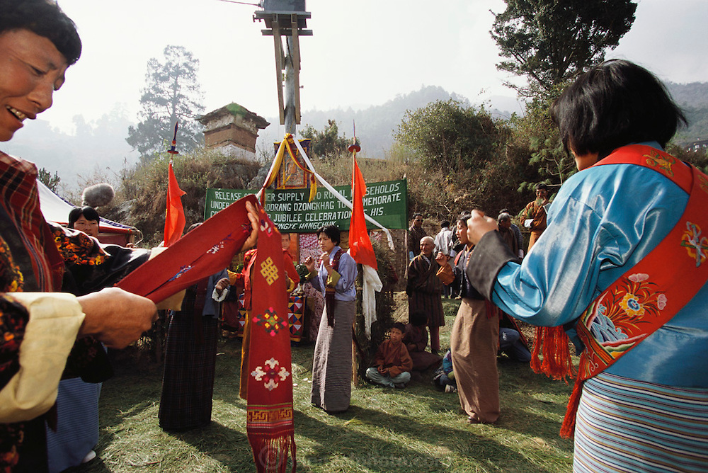Electricity comes to the Bhutanese village of Shingkhey in 2001. Dancers help celebrate the coming of electricity to Shingkhey Village, Bhutan.