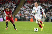 England forward, Wayne Rooney (10) dribbling and driving forward during the Friendly International match between England and Portugal at Wembley Stadium, London, England on 2 June 2016. Photo by Matthew Redman.