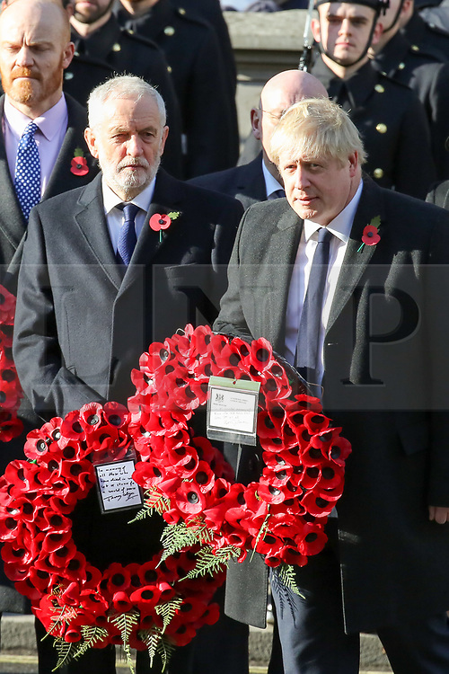© Licensed to London News Pictures. 10/11/2019. London, UK. Prime Minister Boris Johnson lays a wreath at the Cenotaph memorial in Whitehall, central London during the Remembrance Sunday ceremony. Remembrance Sunday is held each year to commemorate the service men and women who fought in past military conflicts. Photo credit: Dinendra Haria/LNP