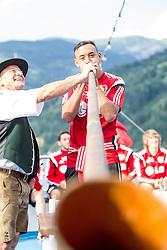 17.07.2014, Zeller See, Zell am See, AUT, Bayer 04 Leverkusen Trainingslager, im Bild Karim Bellarabi (Bayer 04 Leverkusen) blässt das Alphorn // Karim Bellarabi (Bayer 04 Leverkusen) during a Boattrip of the German Bundesliga Club Bayer 04 Leverkusen at the Lake Zell, Zell am See, Austria on 2014/07/17. EXPA Pictures © 2014, PhotoCredit: EXPA/ JFK