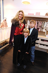 PIA GETTY and her sons MAX (L) and CONRAD (R) at a party to celebrate the opening of Pincess Marie-Chantal of Greece's store 'Marie-Chantal' 133A Sloane Street, London on 14th October 2008.