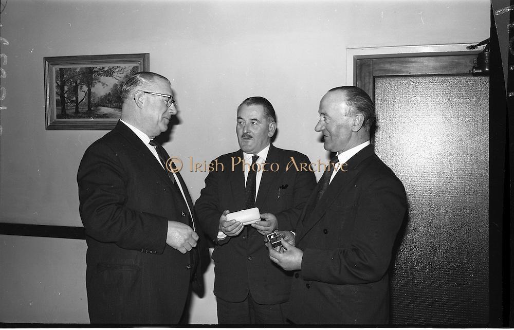 07/02/1964<br /> 02/07/1964<br /> 07 February 1964<br /> Esso staff presentations in Esso premises at Alexandra Road, Dublin. Presentations made by Mr Denis Dunne (left), Director at Esso Petroleum Company (Ireland) Ltd.