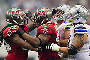 DALLAS, TX - SEPTEMBER 23:  Lavonte David #54 is restrained by Gerald McCoy #93 of the Tampa Bay Buccaneers during a game against the Dallas Cowboys at Cowboys Stadium on September 23, 2012 in Dallas, Texas.  The Cowboys defeated the Buccaneers 16-10.  (Photo by Wesley Hitt/Getty Images) *** Local Caption *** Lavonte David; Gerald McCoy