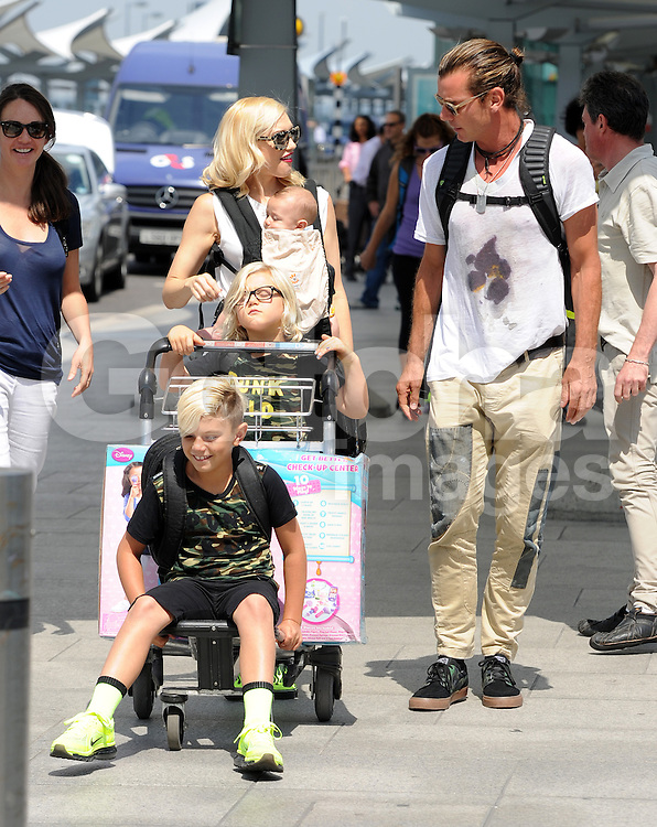 Singer Gwen Stefani, Gavin Rossdale and their three boys Kingston Rossdale, Zuma Nesta Rock Rossdale, Apollo Bowie Flynn Rossdale at Heathrow airport in London, UK. 24/07/2014<br />