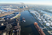 Nederland, Noord-Holland, Amsterdam, 11-12-2013; Westelijk Havengebied, Westhaven (links met Overslagbedrijf Amsterdam (OBA), rechts Sonthaven. Centrale Heweg (kolengestookt) in de achtergrond.<br /> Western Harbour Amsterdam, Westhaven. Mountains of coal and ore Overslagbedrijf Amsterdam (OBA), Transshipment Compagny. Electricityplant, coal fired, in the background.<br /> luchtfoto (toeslag op standaard tarieven);<br /> aerial photo (additional fee required);<br /> copyright foto/photo Siebe Swart.