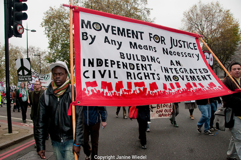 Civil rights banner at Stop the War  March through central London November 20thn 2010