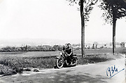 man on a motorcycle rural road France 1934