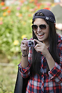 New Hampton, New York - A young woman smiles while taking pictures of a pie-eating contest during the celebration of 100 years in business at Soons Orchards and Farm Market  on Oct. 11, 2010.
