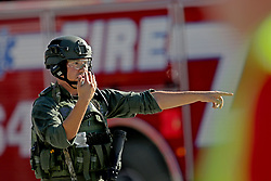 A law enforcement officer directs traffic outside of Stoneman Douglas High School in Parkland, FL, USA, after a shooting on Wednesday, February 14, 2018. Photo by John McCall/Sun Sentinel/TNS/ABACAPRESS.COM