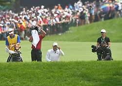 August 12, 2018 - St. Louis, Missouri, U.S. - ST. LOUIS, MO - AUGUST 12: Tiger Woods dries himself off before hitting out of a bunker on the #1 hole during the final round of the PGA Championship on August 12, 2018, at Bellerive Country Club, St. Louis, MO.  (Photo by Keith Gillett/Icon Sportswire) (Credit Image: © Keith Gillett/Icon SMI via ZUMA Press)