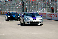 Apr 12, 2003; Long Beach, CA, USA; Actor PETER RECKELL keeps the lead away from JESSE JAMES on the straight away @ the 27th Annual Pro/Celebrity Race in Long Beach racing Toyota Celica race cars.  Driving 10 laps on a 1.97 mile track along shoreline drive. <br />