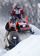 Al Clough (from left) of Cedar Rapids and Chris Rechkemmer of Fairbank battle for first place in the Vintage division at the Frozen Few 1st Inaugural Amateur Sno-X Race held at Hawkeye Downs, 4400 6th Street SW in Cedar Rapids on Saturday January 22, 2011. 1,200 people turned out to watch over 50 racers in 12 divisions at the event sponsored by the Frozen Few Snowmobile Club. A portion of the proceeds went to the Spina Bifida Association of Iowa. The next race is February 19th.