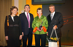 Left to right,  CECILE BONNEFOND President of Veuve Clicquot Ponsardin, the RT.HON.GORDON BROWN MP   winner of the 2006 Veuve Clicquot Award VIVIENNE COX, and DAVID MEYERS MD Moet Hennessy UK Ltd at a reception for the winners of the 2006 Veuve Clicquot Award - Business Woman of the Year held at Claridge's Hotel, brook Street, London on 27th April 2006.  This years winner was Vivienne Cox, BP CEO for Gas, Power, Renewables and Integrated Supply & Trading.  The awards were presented by the Rt.Hon.Gordon Brown MP - The Chancellor of the Exchequer.<br /><br /><br />NON EXCLUSIVE - WORLD RIGHTS