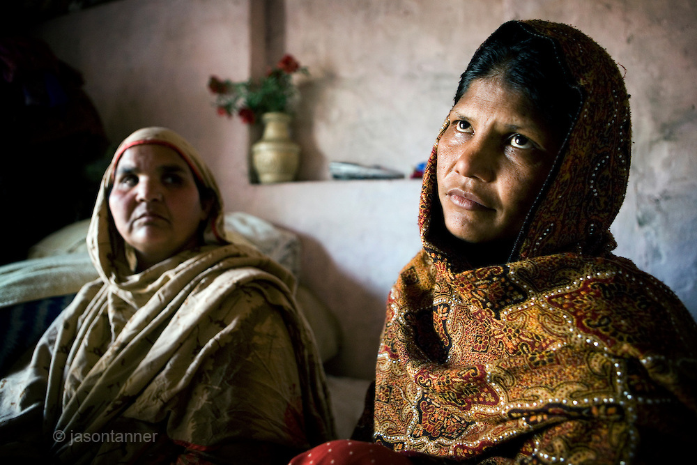 LAHORE: The Aunt (left), and Mother of Shazia Masih, a 12 year old young maid allegedly tortured to death by her employer, Chaudhry Naeem on January 19 2010...Shazia died at Jinnah Hospital three days after an incident at the home of her employer in the affluent Defence Housing Area in Lahore, Pakistan...Shazia had been employed as a housemaid on a salary of Rs1000 per month at the home of a lawyer and the former President of Lahore Bar Association for the past eight months.
