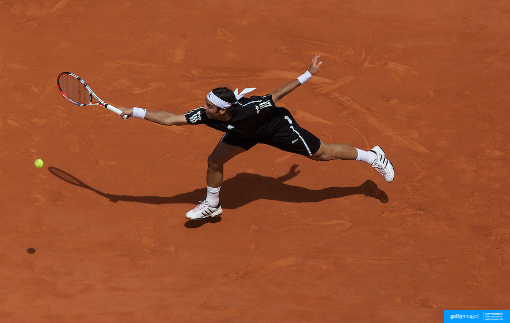 Fernando Gonzalez, Chile, in action against Robin Soderling, Sweden, during the Men's Semi-Final match at the French Open Tennis Tournament at Roland Garros, Paris, France on Friday, June 5, 2009. Photo Tim Clayton.