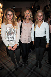 JULIET HERD and her daughters GEORGIA and ELLIE at the Juicy Couture children's tea party in aid of Mothers 4 Children held at the Juicy Couture Store, Bruton Street, London on2nd December 2009.