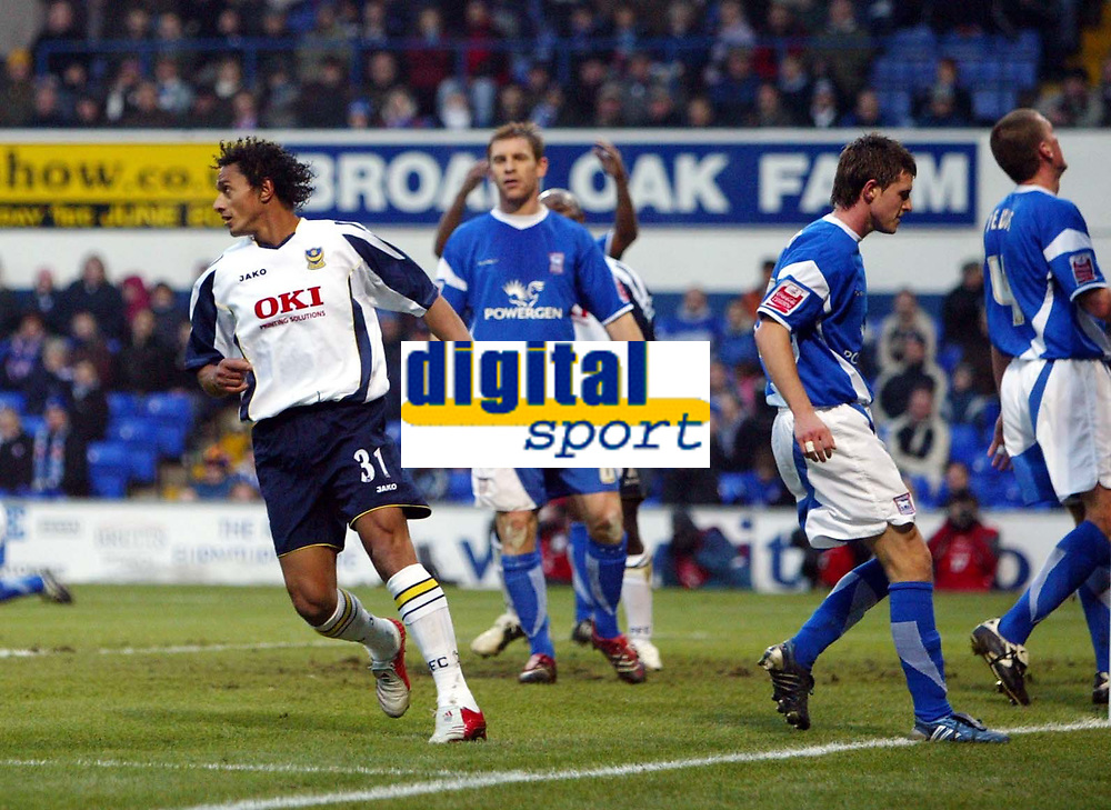 Photo: Chris Ratcliffe.<br />Ipswich Town v Portsmouth. The FA Cup. <br />07/01/2006.<br />Darius Silva (L) turns away in delight at scoring the first Portsmouth goal as Ipswich players hang their heads.
