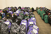 KLA-Tencor employees packed backpacks with school supplies during a Back-To-School event at KLA-Tencor in Milpitas, California, on July 31, 2014. (Stan Olszewski/SOSKIphoto)