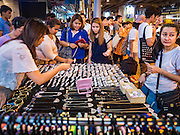 26 MAY 2016 - BANGKOK, THAILAND: Thai women shop for costume jewelry in the Silom Road night market. The night market on Silom Road, close to Bangkok's famous Patpong tourist area, is being closed by the Bangkok municipal government. Vendors have been told they have to leave the sidewalk on Silom Road by the end of May, 2016. The market is the latest street market being shut down by city officials as a part of the government's plan to clean up Bangkok. The Silom Road night market sells mostly tourist oriented clothes, inexpensive Thai art, and bootleg movies on DVD.       PHOTO BY JACK KURTZ