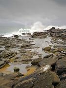 Views of Waipapa Point and Waipapa Lighthouse, south end of South Island, New Zealand, on a blustery, windy, wet day.