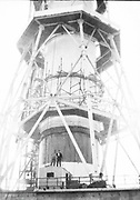 """AMAZING Photo Film discovered Documenting Work In Chernobyl <br /> Chernobyl worker Aleksandr Shubovskiy captures rare images <br /> <br /> During one of the days in 1979-80, when the erection of Ventilation Stack VT-2 common for the third and fourth (not existed at that time) Chernobyl NPP Units was coming to the end, Aleksandr Shubovskiy, who was working within a combined installation crew in a company named """"Spetsenergomontazh"""", arranged with the colleagues a small photo session on his own,They had their pictures taken.<br /> <br /> The author processed the film and put it on a wardrobe  until he had time to print the images. The moment to print the film somehow did not happen, while in February 1986 Aleksandr hit the road for a on a different site in Yakutia. And there he was caught by news about the accident at Chernobyl.<br /> <br /> A year later, when a Aleksandr  managed to get into his looted flat in the evacuated Pripyat, he discovered an untouched package with films. He brought them home and… forgot for almost 40 years…the printed photographs which no one and never have seen before until now<br /> <br /> Photo shows: Members of a combined crew. All equipped with safety harnesses, chains and hooks for working at heights. One of the workers, supposedly, holds a walky-talky for communication with a crane operator.<br /> ©Aleksandr Shubovskiy/Exclusivepix Media"""