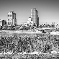 Milwaukee Skyline and Lakeshore State Park black and white picture. Image includes the Lakeshore State Park Inlet, University Club Tower, Northwestern Mutual Tower, and Milwaukee Art Museum. Lakeshore State Park is a Wisconsin State Park with walking trails and public recreational activities. Photo is high resolution.