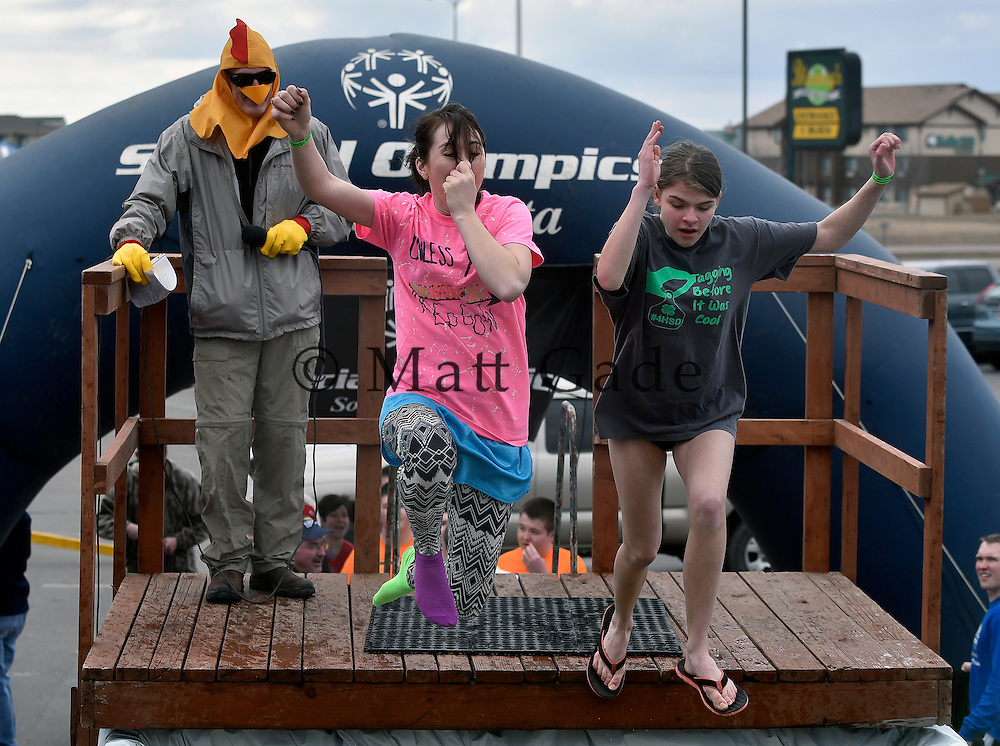 Plungers make a splash in the annual Mitchell Special Olympics/Special Olympics South Dakota Polar Plunge on Sunday afternoon in the Highland Mall parking lot. There were 63 plungers who raised $26,000 for this year's polar plunge. (Matt Gade/Republic)
