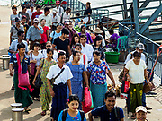 20 NOVEMBER 2017 - YANGON, MYANMAR: Passengers walk down to the Dala Ferry from the Dala terminal. Tens of thousands of commuters ride the ferry every day. It brings workers into Yangon from Dala, a working class community across the river from Yangon. A bridge is being built across the river, downstream from the ferry to make it easier for commuters to get into the city.     PHOTO BY JACK KURTZ