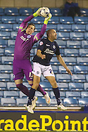David Stockdale of Brighton and Hove Albion (left) collects the ball under pressure from Gary Taylor-Fletcher of Millwall (right) during the Sky Bet Championship match at The Den, London<br /> Picture by David Horn/Focus Images Ltd +44 7545 970036<br /> 17/03/2015