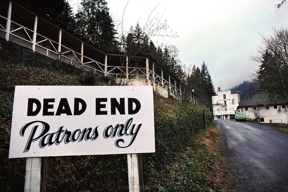 Hot Springs resort sign reading: Dead End, Patrons Only. Oregon. USA.