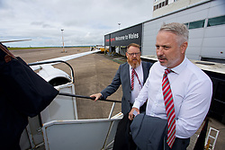 CARDIFF, WALES - Monday, September 4, 2017: Wales' coach Kit Symons and head of international affairs Mark Evans boards the team plane as the squad depart Cardiff Airport to travel to Chișinău ahead of the 2018 FIFA World Cup Qualifying Group D match against Moldova. (Pic by David Rawcliffe/Propaganda)