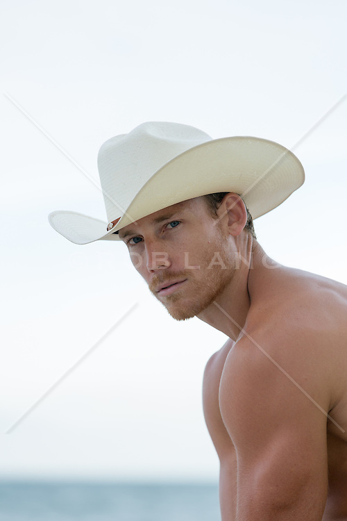 portrait of a shirtless cowboy outdoors