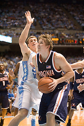 UVA's Laurynas Mikalauskas (11) prepares a shot as UNC's Tyler Hansbrough (50) blocks on defense.  Mikalauskas made the shot and was fouled on the play.  The #1 ranked Tar Heels beat the Cavaliers 79-69 to improved to 15-1 overall, 2-0 ACC on January 10, 2007 at the Dean Smith Center in Chapel Hill, NC...<br />