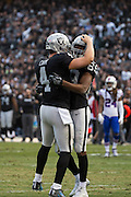 Oakland Raiders wide receiver Amari Cooper (89) and Oakland Raiders quarterback Derek Carr (4) celebrate after a touchdown against the Buffalo Bills at Oakland Coliseum in Oakland, Calif., on December 4, 2016. (Stan Olszewski/Special to S.F. Examiner)