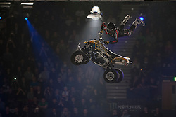© licensed to London News Pictures. London, UK 14/03/2012. An ATV rider is performing a stunt  in the air as Masters of Dirt show takes place in Wembley Arena in London. Photo credit: Tolga Akmen/LNP