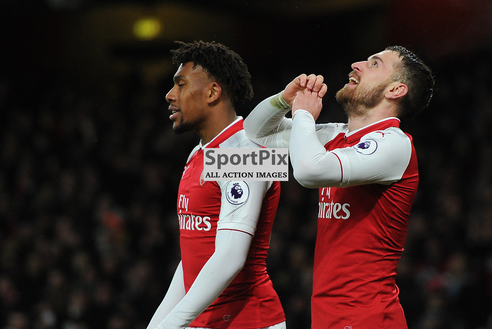 Aaron Ramsey of Arsenal celebrates with teammate Alex Iwobi after scoring his sides fifth goal and completing his hatrick during Arsenal vs Everton, Premier League, 03.02.18 (c) Harriet Lander | SportPix.org.uk