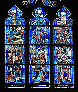 Army of Joan of Arc taking the tower of Bethemont in 1429, an event which took place in the Poissy area during the Hundred Years War, stained glass window, 1941, in the Collegiale Notre-Dame de Poissy, a catholic parish church founded c. 1016 by Robert the Pious and rebuilt 1130-60 in late Romanesque and early Gothic styles, in Poissy, Yvelines, France. The tower and Montjoie castle formed a defensive line around Paris. The Collegiate Church of Our Lady of Poissy was listed as a Historic Monument in 1840. Picture by Manuel Cohen