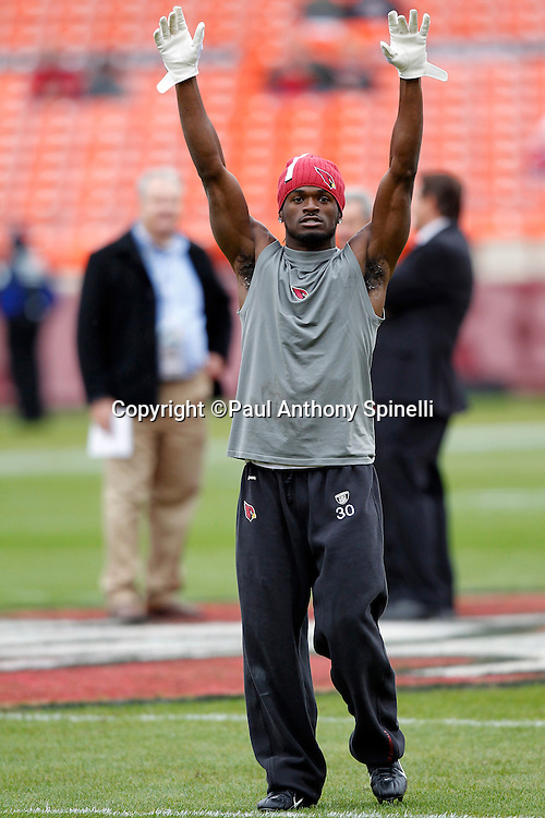 Arizona Cardinals cornerback Marshay Green (30) raises his arms while warming up before the NFL week 17 football game against the San Francisco 49ers on Sunday, January 2, 2011 in San Francisco, California. The 49ers won the game 38-7. (©Paul Anthony Spinelli)