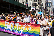 New York, NY - 30 June 2019. The New York City Heritage of Pride March filled Fifth Avenue for hours with participants from the LGBTQ community and it's supporters. New York Governor Mario Cuome, center, hand raised high, was greeted with loud applause for having signed the law making same-sex marriage legal in New York in 2011.