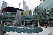 Visitors take photos in front of the fountains and large cross outside the new $130 million campus for First Baptist Dallas on Easter Sunday, March 31, 2013. (Cooper Neill/The Dallas Morning News)