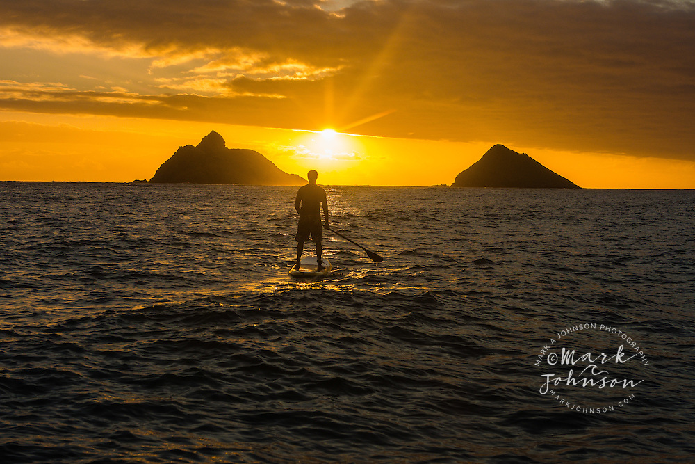 Stand-Up Paddle Boarding at sunrise off the Mokulua Islands, Lanikai, Kailua Bay, Oahu, Hawaii
