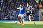 Portsmouth defender Christian Burgess (6) and Notts County forward Aaron Collins (39) during the EFL Sky Bet League 2 match between Portsmouth and Notts County at Fratton Park, Portsmouth, England on 22 October 2016. Photo by David Charbit.